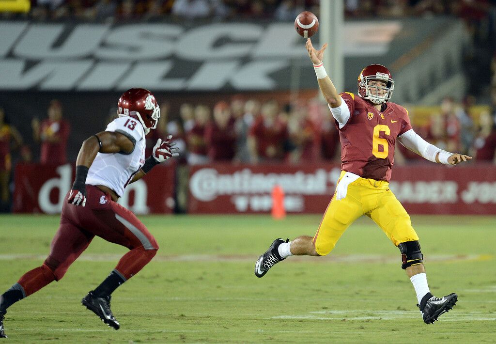. USC\'s Cody Kessler passes the ball as Washington State\'s Darryl Monroe #13 moves in during their game at the Los Angeles Memorial Coliseum  Saturday, September 7, 2013.  (Photo by Hans Gutknecht/Los Angeles Daily News)
