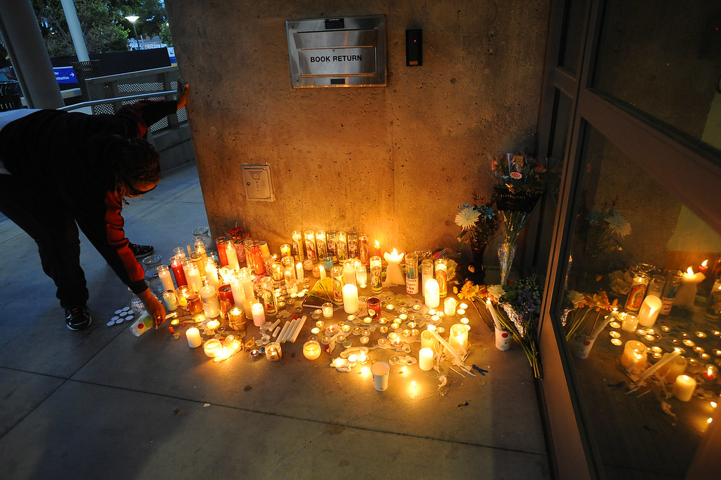 . Candles burn outside the library at Santa Monica College Monday, June 10, 2013.(Andy Holzman/Los Angeles Daily News)