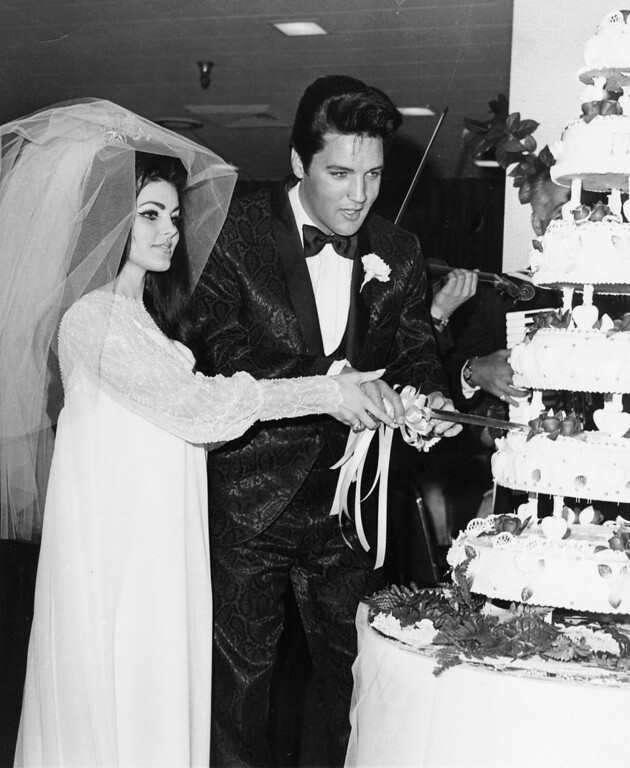 . This May 1967 file photo of Elvis Presley and his new bride Priscilla cutting the cake at their wedding reception in Las Vegas. (AP Photo)