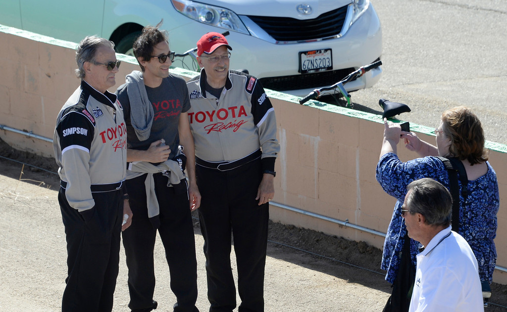 . March 15,2014. Rosamond CA. (L-R) Celebrities Eric Braeden, Adrien Brody and VP of Ochsner Health System Dr. William Pinsky pose for photos  at the Willow Springs International Raceway. photo  by Gene Blevins/LA DailyNews