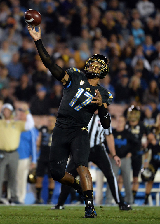 . UCLA Bruins quarterback Brett Hundley (17) passes against the Washington Huskies during the first half of their college football game in the Rose Bowl in Pasadena, Calif., on Friday, Nov. 15, 2013.  UCLA won 41-31. 