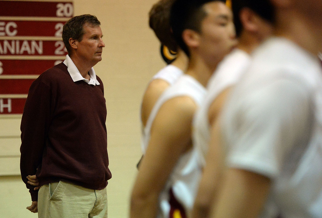 . La Canada head coach Tom Hofman during the national anthem as he would go on to win his 600th game as they defeated La Salle 73-62 during a prep basketball game at La Canada High School in La Canada, Calif., on Friday, Jan. 10, 2014. Hofman record is 600 wins and 186 losses since becoming varsity head coach in the 1986-87 season. (Keith Birmingham Pasadena Star-News)