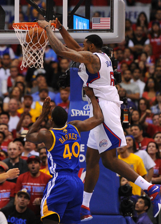 . The Clippers\' DeAndre Jordan dunks on the Warriors late in game seven of the Western Conference playoffs, Saturday, May 3, 2014, at Staples Center. (Photo by Michael Owen Baker/L.A. Daily News)