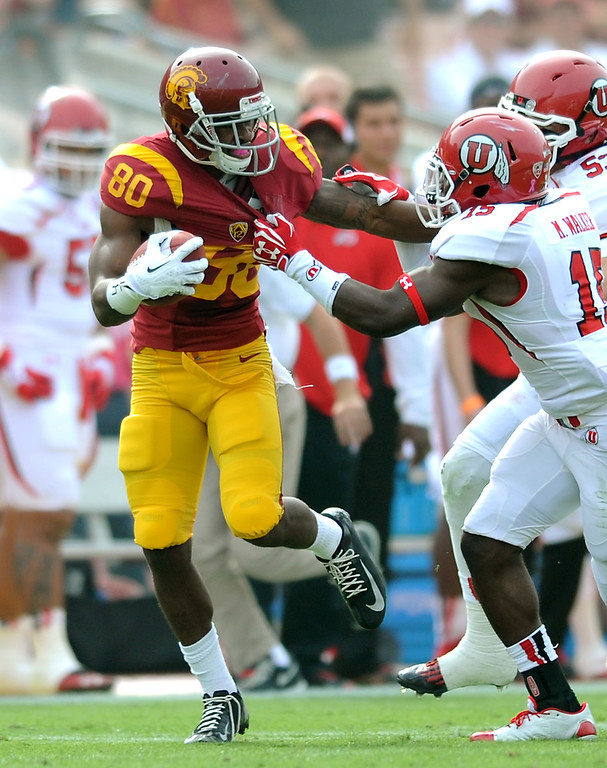 . USC WR De\'Von Flournoy goes for a first down on third-and-22 against Utah in the second quarter, Saturday, October 26, 2013, at the L.A. Memorial Coliseum. (Michael Owen Baker/L.A. Daily News)
