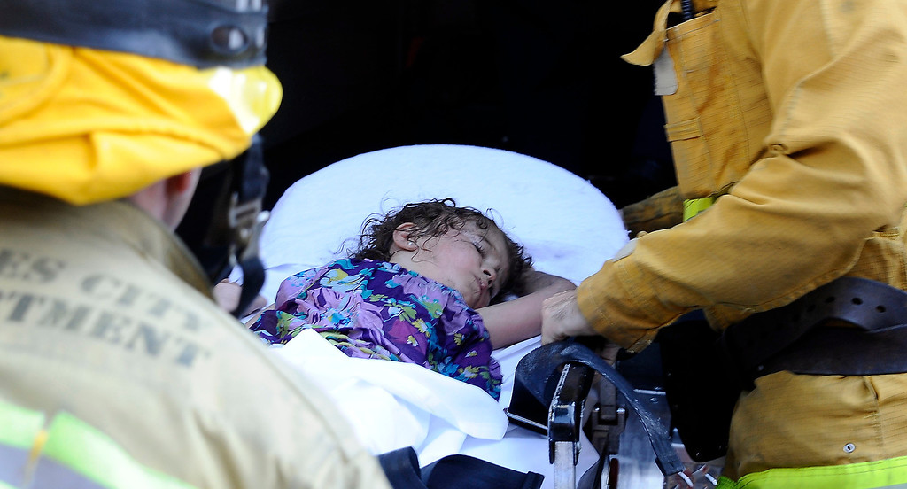 . A 2yr old little girl is transported to  UCLA after being found on the 23rd floor in a hall way, as LA city firefighters battle a condo fire on the 11th floor on 11740 Wilshire Bl. in Brentwood Friday. It took  214 firefighters took  71 minutes to fully extinguish the blaze. A few people were treated for minor smoke. Brentwood CA. Oct 18,2013.  Photos by Gene Blevins/LA Daily News