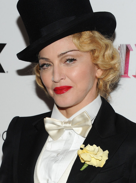 ". Singer Madonna attends the world premiere of ""Madonna: The MDNA Tour\"" hosted by The Cinema Society and Dolce & Gabbana at the Paris Theatre on Tuesday, June 18, 2013 in New York. (Photo by Evan Agostini/Invision/AP)"