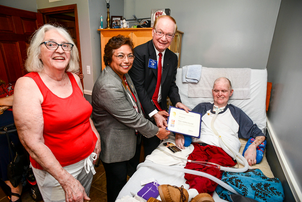 . L to R, Alyce Garcia, Elsa Gillham of Rotary International, Paul Netzel, Trustee of Rotary Foundation, and Joe Garcia of Chatsworth Tuesday, July 15, 2014.  Netzel presented Garcia with the Paul Harris Fellow award.  Garcia, 73, has been paralyzed from the neck down from polio since 1960, his sister-in-law Alyce has cared for him during the last 53 years.    ( Photo by David Crane/Los Angeles Daily News )