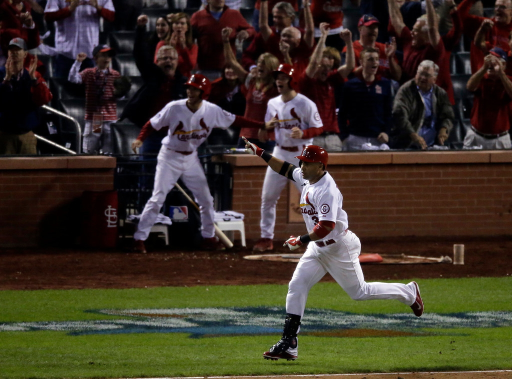 . St. Louis Cardinals\' Carlos Beltran celebrates after hitting his game-winning hit during the 13th inning of Game 1 of the National League baseball championship series against the Los Angeles Dodgers Saturday, Oct. 12, 2013, in St. Louis. (AP Photo/Chris Carlson)