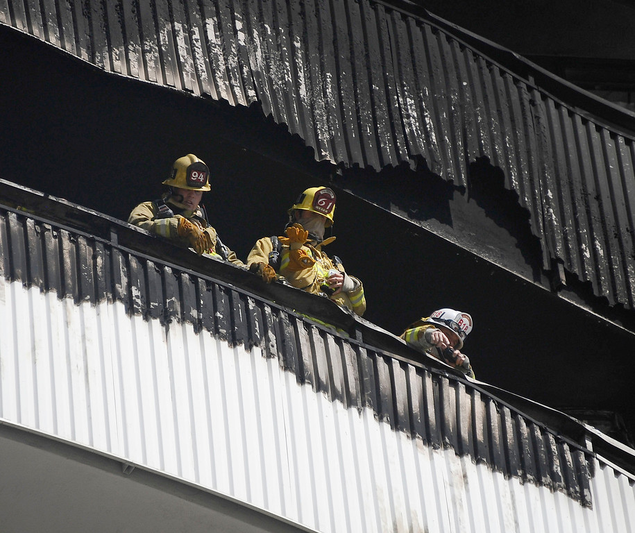 . LA city firefighters battle a condo fire on the 11th floor on 11740 Wilshire Bl. in Brentwood Friday. It took  214 firefighters took  71 minutes to fully extinguish the blaze. A few people were treated for minor smoke. Brentwood CA. Oct 18,2013.  Photos by Gene Blevins/LA Daily News