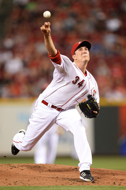 . CINCINNATI, OH - SEPTEMBER 8:  Homer Bailey #34 of the Cincinnati Reds pitches in the first inning against the Los Angeles Dodgers at Great American Ball Park on September 8, 2013 in Cincinnati, Ohio.  (Photo by Jamie Sabau/Getty Images)