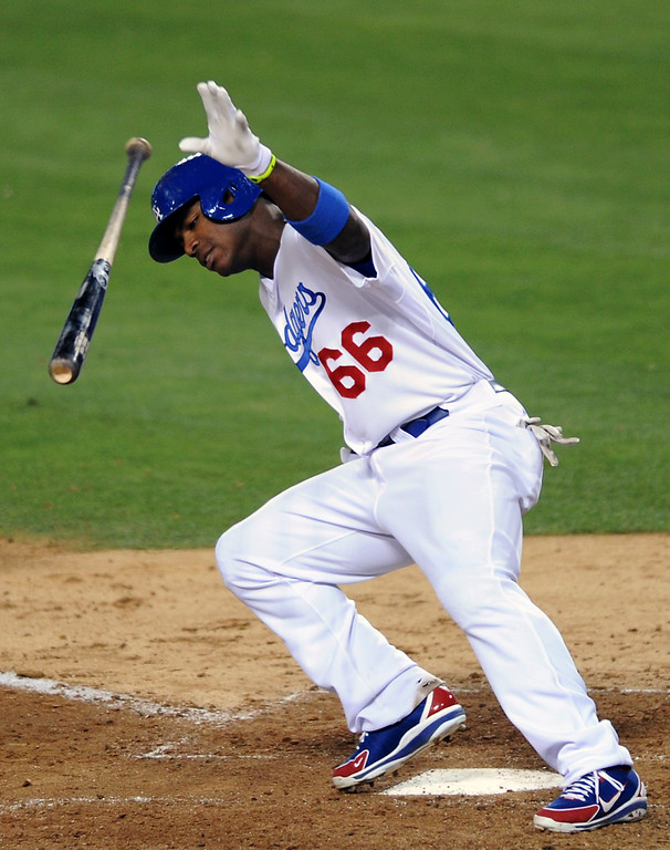 . The Dodgers\' Yasiel Puig tosses his bat after hitting a pop up against the Red Sox Friday, August 23, 2013. (Michael Owen Baker/L.A. Daily News)