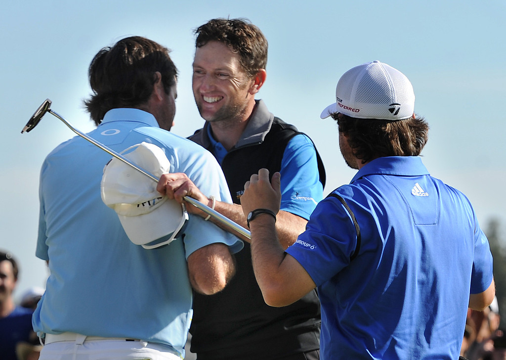 . Bubba Watson gives a hug to Jason Allred as Brian Harman moves in for congratulations. Watson won the 2014 Northern Trust Open. Pacific Palisades, CA. February 16, 2014 (Photo by John McCoy / Los Angeles Daily News)