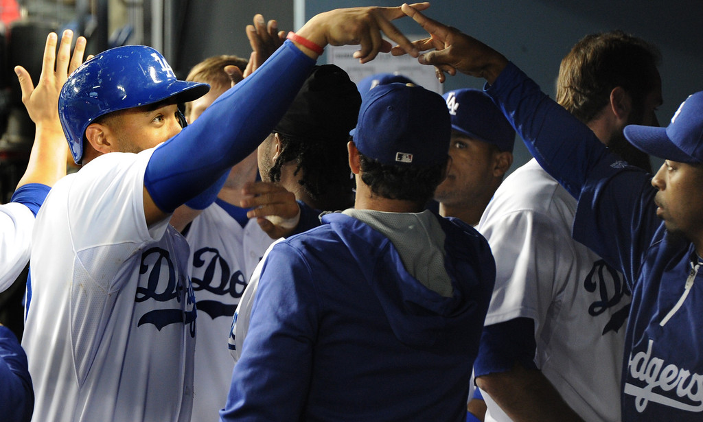. Matt Kemp is congratulated  after being driven in on a 3 RBI double hit by Miguel Rojas in the 3rd inning. The Dodgers played the Colorado Rockies at Dodger Stadium in Los Angeles, CA. 6/18/2014(Photo by John McCoy Daily News)