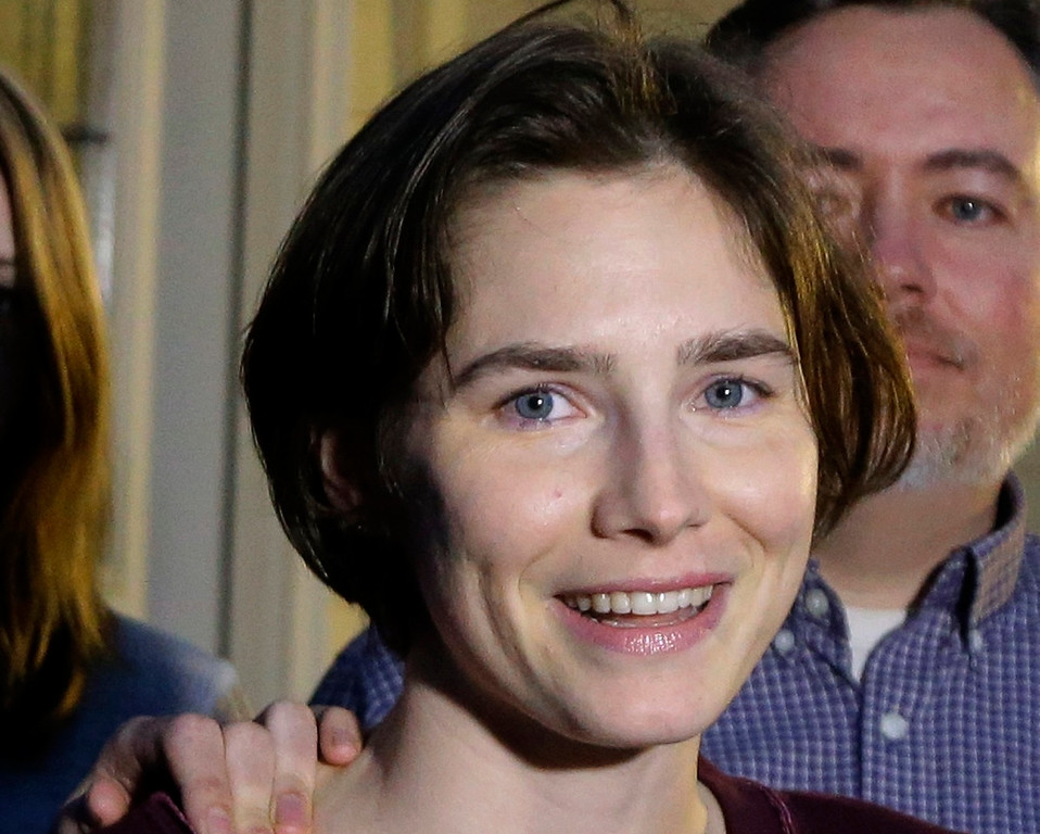 . Amanda Knox talks to members of the media outside her mother\'s home, Friday, March 27, 2015, in Seattle. Italy\'s highest court overturned the murder conviction against Knox and her ex-boyfriend Friday over the 2007 slaying of Knox\'s roommate, bringing to a definitive end the high-profile case. (AP Photo/Ted S. Warren)