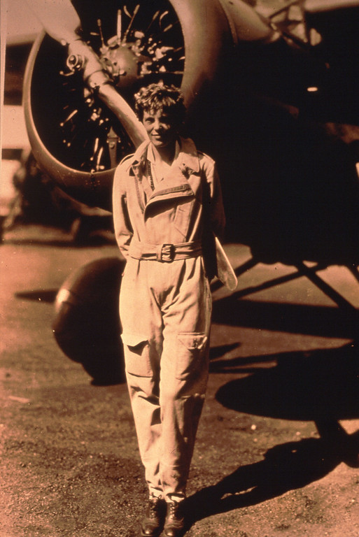 . Photo of pilot Amelia Earhart standing by her plane. (Photo by Getty Images)