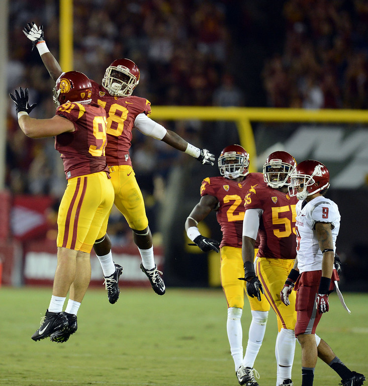 . USC\'s Dion Bailey #18 celebrates after grabbing an interception as Washington State\'s Gabe Marks #9 looks on at the Los Angeles Memorial Coliseum  Saturday, September 7, 2013.  (Photo by Hans Gutknecht/Los Angeles Daily News)