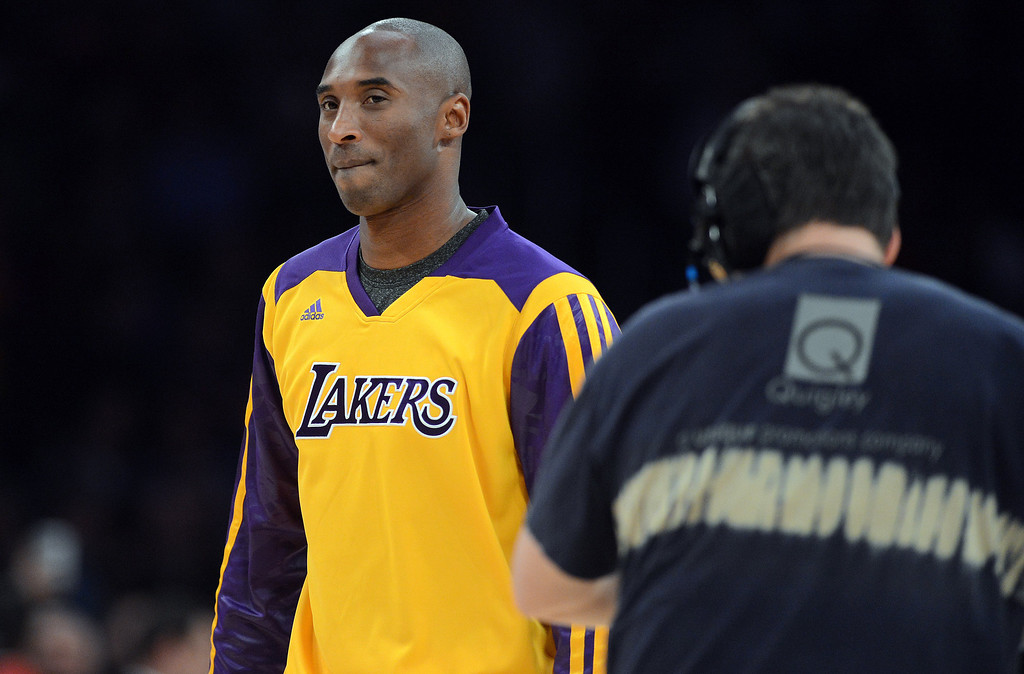 . The Lakers� Kobe Bryant made an appearance during their game against the Grizzlies to present a check for victims of the Philippine  typhoon at the Staples Center in Los Angeles Friday, November 15, 2013. (Photo by Hans Gutknecht/Los Angeles Daily News)