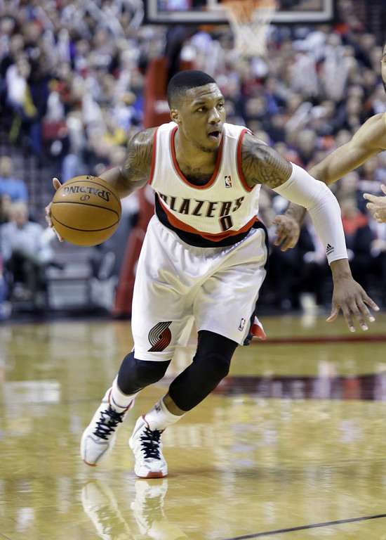 . Portland Trail Blazers guard Damian Lillard is shown during the second half of an NBA basketball game against the Los Angeles Lakers in Portland, Ore., Monday, March 3, 2014.(AP Photo/Don Ryan)