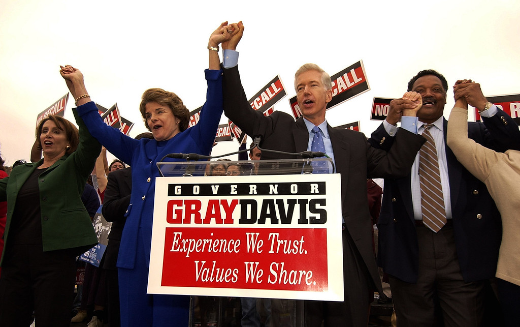 """. Nancy Pelosi (D-Ca), House Minority Leader, left, Sen. Diane Feinstein, second left, and Rev. Jesse Jackson, right, join California Gov. Gray Davis after attending a labor rally at Teamster\'s Hall in Oakland, Calif., Saturday, Oct. 4, 2003, to kick-off a three day \""""Just Say No!\"""" fly-around. (AP Photo/Kevork Djansezian)"""