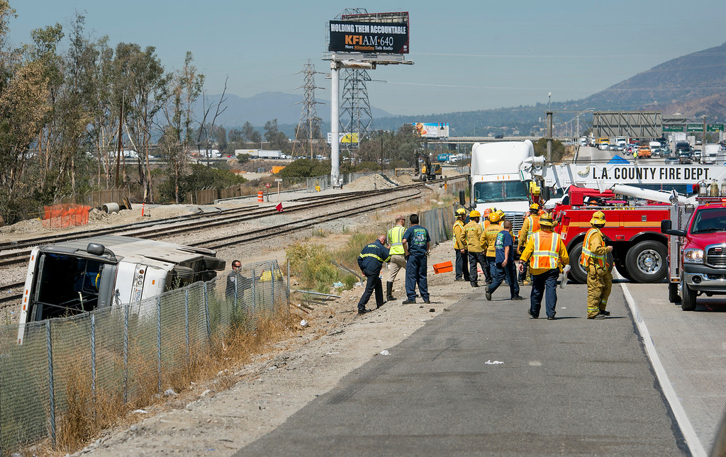 . Fifty-two injured passengers were transported to area hospitals after a tour bus overturned on the eastbound 210 Freeway in Irwindale, Calif. just east of the 605 Freeway Thursday morning, August 22, 2013.   (SGVN/Staff photo by Leo Jarzomb)