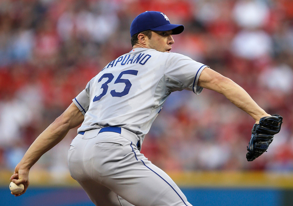 . Los Angeles Dodgers starting pitcher Chris Capuano throws against the Cincinnati Reds in the first inning of a baseball game, Friday, Sept. 6, 2013, in Cincinnati. (AP Photo/Al Behrman)