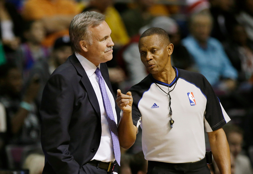 . Los Angeles Lakers head coach Mike D\'Antoni, left, listens to referee Michael Smith during the first quarter of an NBA basketball game against the Detroit Pistons at the Palace in Auburn Hills, Mich., Friday, Nov. 29, 2013. (AP Photo/Carlos Osorio)