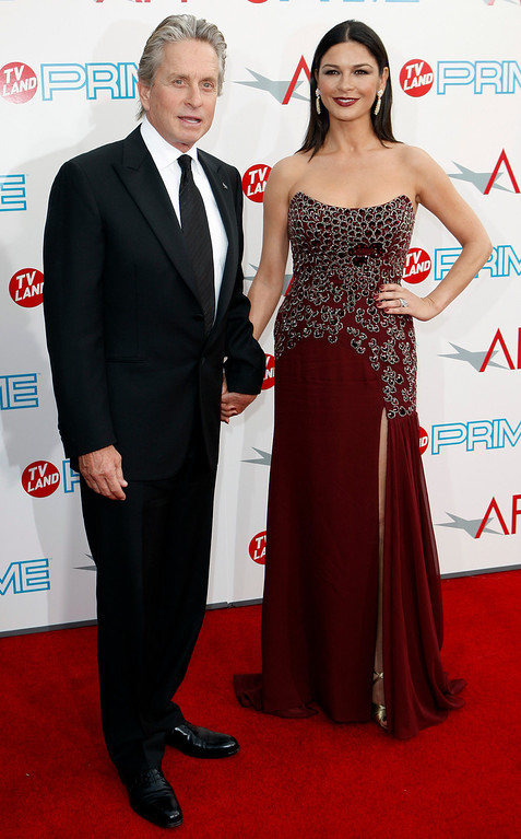 . Actors Michael Douglas, left, and Catherine Zeta-Jones arrive at the taping of the American Film Institute\'s Life Achievement Awards honoring Douglas in Culver City, Calif. on Thursday, June 11, 2009. (AP Photo/Matt Sayles)