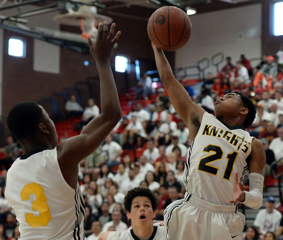 . Bishop Montgomery \'s Justin Bibbins (21) rebounds against Cantwell in the first half of a CIF Southern California Regional Division IV basketball game at Colony High School in Ontario, Calif., on Saturday, March 22, 2014.  (Keith Birmingham Pasadena Star-News)