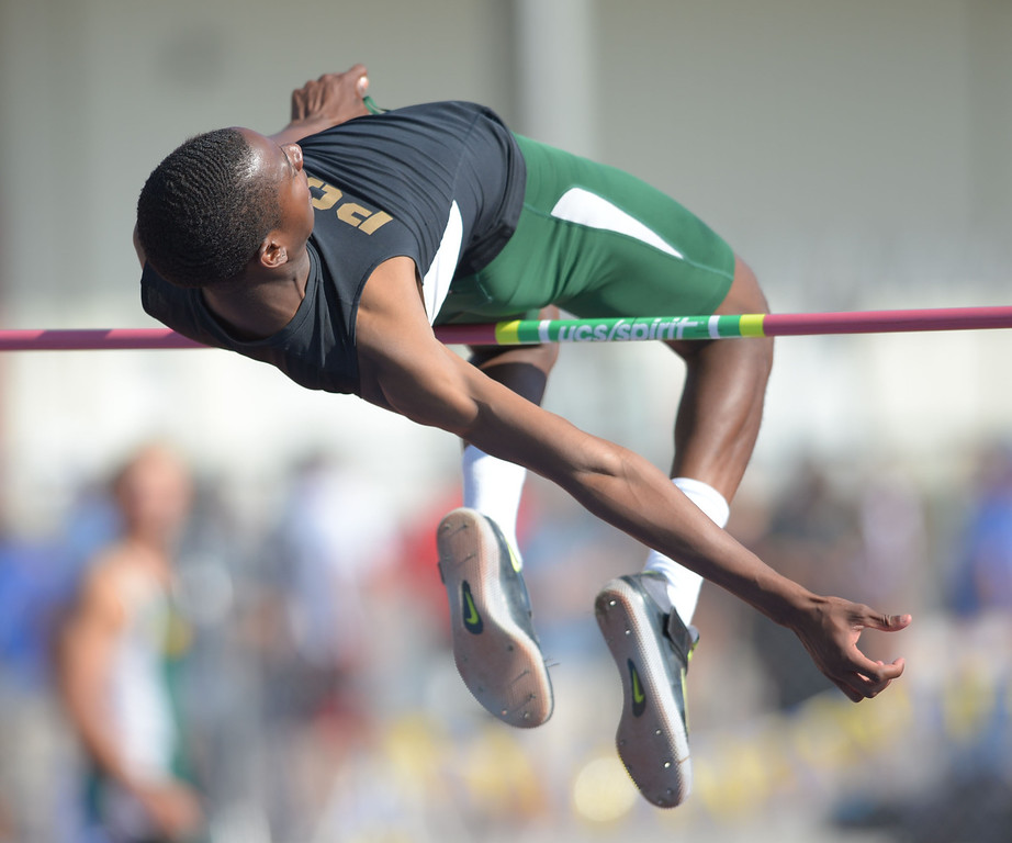 . Long Beach Poly\'s Vincent Calhoun clears 6\'7\'\' in the Division 1 high jump of the CIF Southern Section Track and Field Championships Saturday at Mt. SAC. 20130518 Photo by Steve McCrank / Staff Photographer