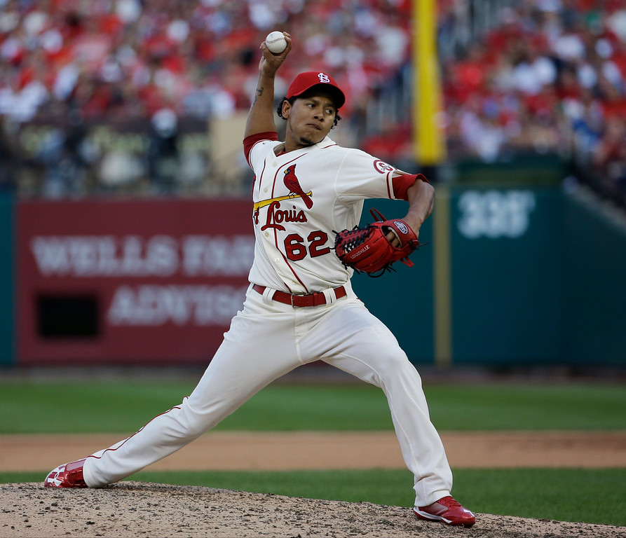 . St. Louis Cardinals relief pitcher Carlos Martinez throws during the eighth inning of Game 2 of the National League baseball championship series against the Los Angeles Dodgers Saturday, Oct. 12, 2013, in St. Louis. (AP Photo/David J. Phillip)