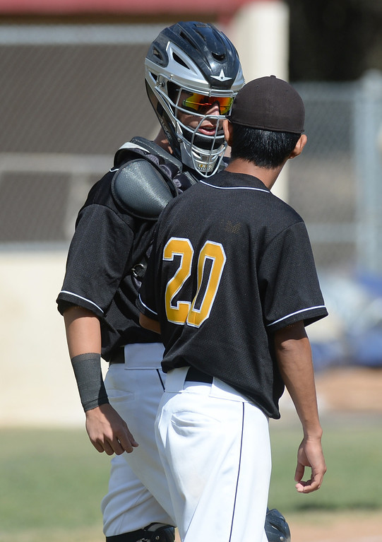 . Santa Fe catcher Eddie Fournier (#21) talks with pitcher Martin Serna (#20) as they play La Serna in their Del Rio League baseball game at La Serna High School in Whittier on Wednesday April 2, 2014. Santa Fe defeated La Serna 2-0. (Staff Photo by Keith Durflinger/Whittier Daily News)