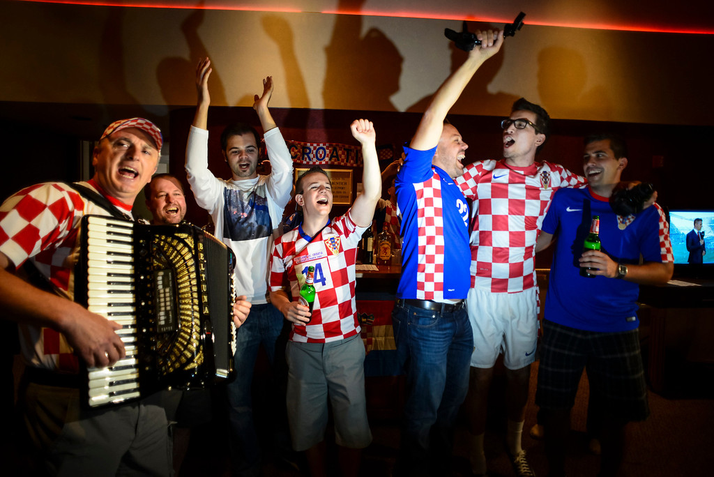. Croatian fans rally as Ivan Sep of Long Beach plays traditional Croatian music before the start of the world cup soccer match between Brazil and Croatia.  Croatian fans gathered at St. Anthony Croatian Catholic Church in Los Angeles for the match which was the first one of the world cup.   ( Photo by David Crane/Los Angeles Daily News )