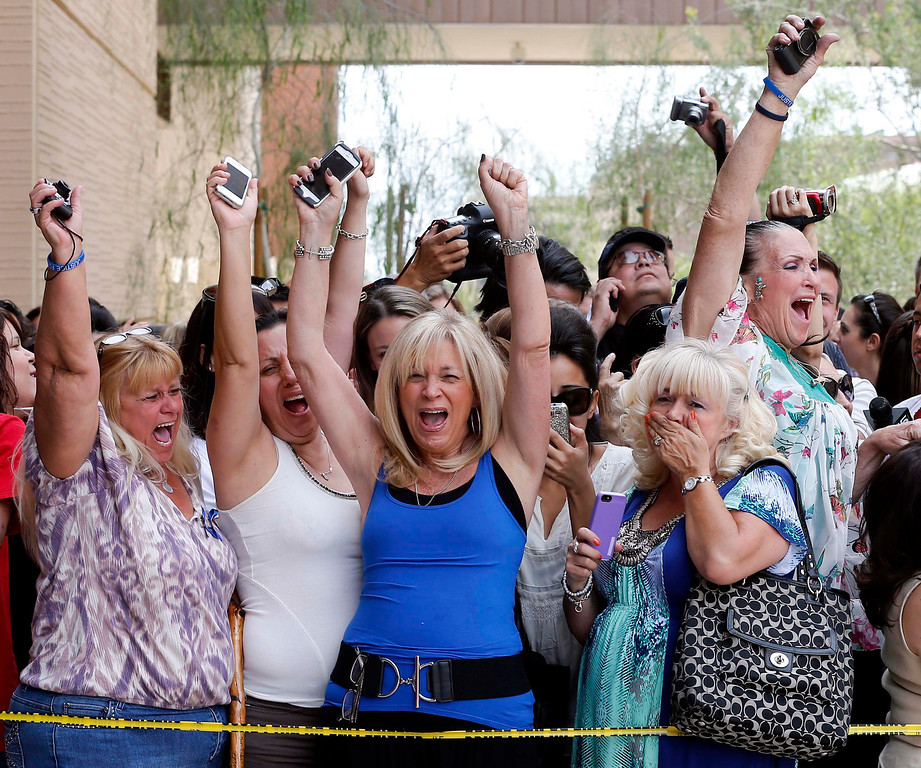 . Spectators react to a guilty verdict in the murder trial of Jodi Arias, Wednesday, May 8, 2013 in Phoenix. Arias was convicted of first-degree murder Wednesday in the 2009 killing of her one-time boyfriend Travis Alexander after a four-month trial.  (AP Photo/Matt York)