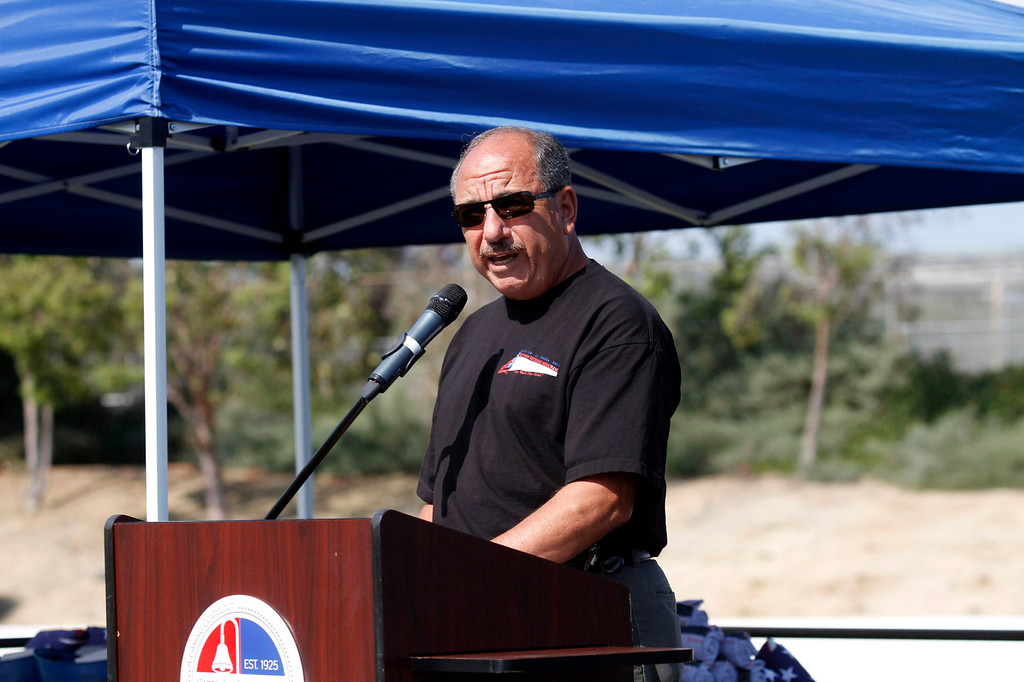 """. Raul Luna, a Vietnam Veteran, Purple Heart & Bronze Star Recipient, gives the introduction, during the Vietnam Veterans Memorial \""""The Wall That Heals\"""" Closing Ceremony event, at La Habra High School, in La Habra, Sunday, July 14, 2013. (SGVN/Correspondent Photo by James Carbone)"""