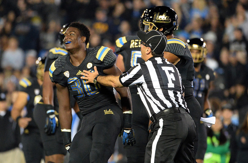 . UCLA Bruin running back Myles Jack (30) reacts after scoring one of his four touchdowns against Washington Huskies during the first half of their college football game in the Rose Bowl in Pasadena, Calif., on Friday, Nov. 15, 2013. 