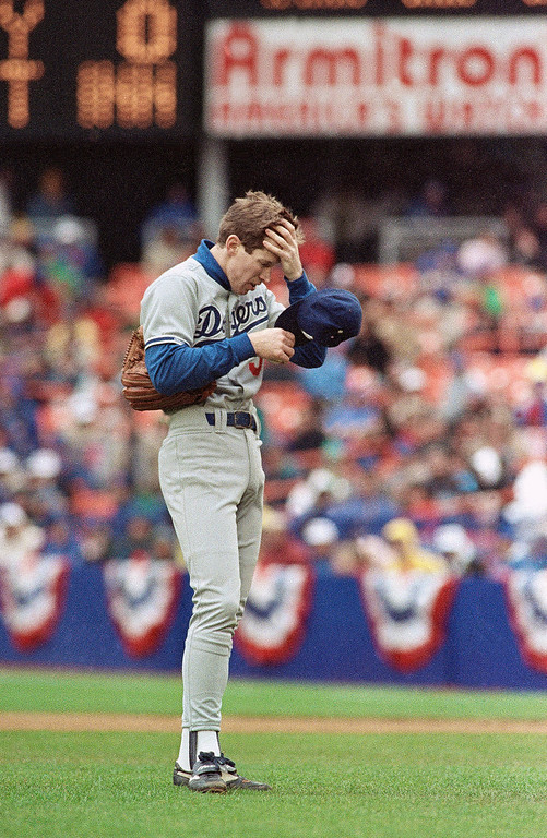 . Los Angeles Dodgers pitcher Orel Hershiser takes a moment in back of the mound early in NL playoff game against the Mets, Saturday, Oct. 8, 1988, New York. Hershiser was in control at times, and struggled at times, in his second outing of the playoffs. (AP Photo/Ron Frehm)