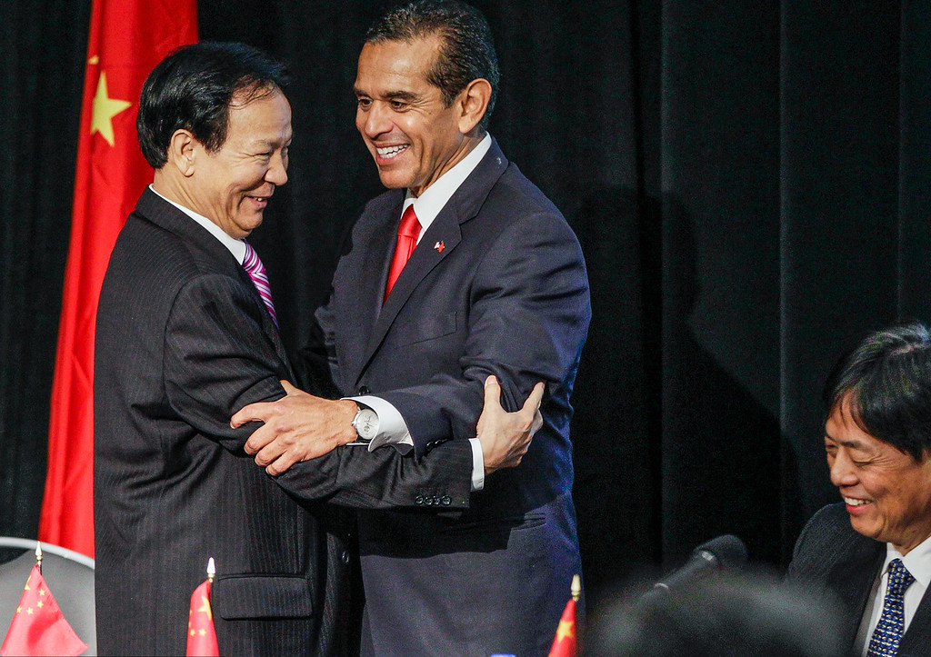 . Chinese Consul General Qiu Shaofang, left, greets Los Angeles Mayor Antonio Villaraigosa during the seventh annual Sino-U.S. Mayors Summit in Los Angeles Tuesday, May 14, 2013.  (AP Photo/Damian Dovarganes)