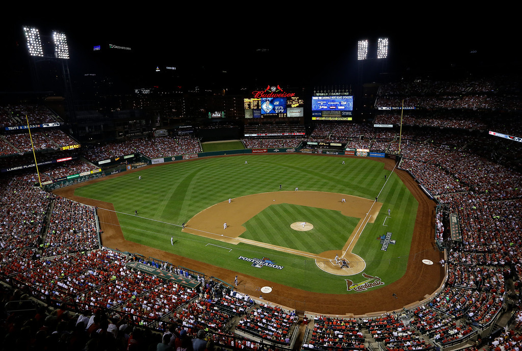 . Fans watch during the first inning of Game 1 of the National League baseball championship series between the St. Louis Cardinals and the Los Angeles Dodgers Friday, Oct. 11, 2013, in St. Louis. (AP Photo/Charlie Neibergall)