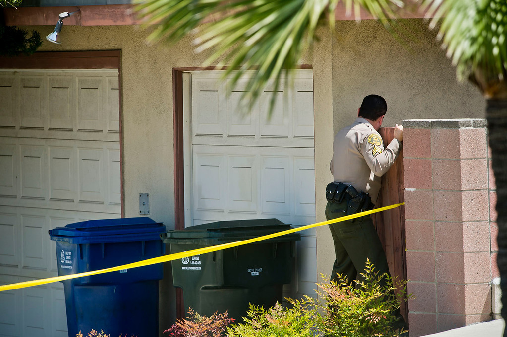 . Los Angeles sheriff\'s officials investigate at a home in the 15900 block of Ladysmith Street in Hacienda Heights where two elderly women and an elderly man were found fatally shot on Wednesday, May 1, 2013. (SGVN/Staff photo by Watchara Phomicinda)