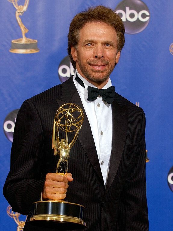. Jerry Bruckheimer poses with his trophy for outstanding reality-competition program the Amazing Race at the 56th Annual Primetime Emmy Awards, Sunday, Sept. 19, at the Shrine Auditorium in Los Angeles. (AP Photo/Reed Saxon)