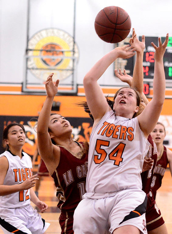 . South Pasadena\'s Sophia Hathaway (54) gets a rebound as they defeat La Canada 66-58 Friday night, January 31, 2014 at South Pasadena High School. (Photo by Sarah Reingewirtz/Pasadena Star-News)