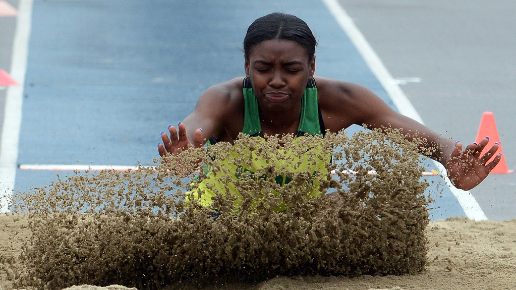 . Long Beach Poly\'s Zhane Smith competes in the division 1 long jump during the CIF Southern Section track and final Championships at Cerritos College in Norwalk, Calif., on Saturday, May 24, 2014. 