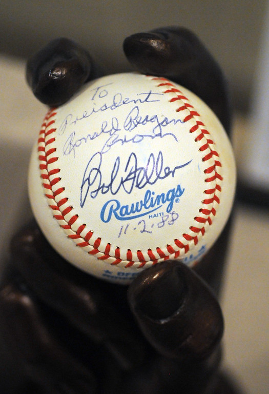 """. A Bob Feller fast ball cast and ball are included in the \""""Baseball!\"""" exhibit. The Exhibition opens April 4, 2014 at the Ronald Reagan Presidential Library and Museum.  Running through September 4, 2014, Baseball is a 12,000 square foot exhibition featuring over 700 artifacts, including some of the rarest, historic and iconic baseball memorabilia.  (Photo by Dean Musgrove/Staff Photographer)"""