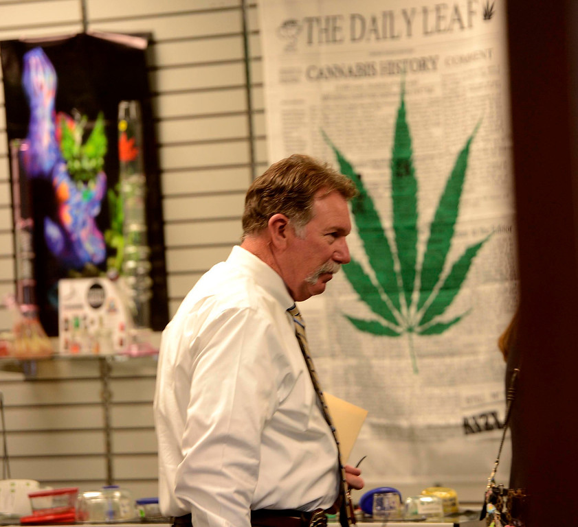 . A City Attorney investigator enters the S.B.P.C. medicinal marijuana dispensary during a bust in San Bernardino May 29, 2013.  GABRIEL LUIS ACOSTA/San Bernardino Sun