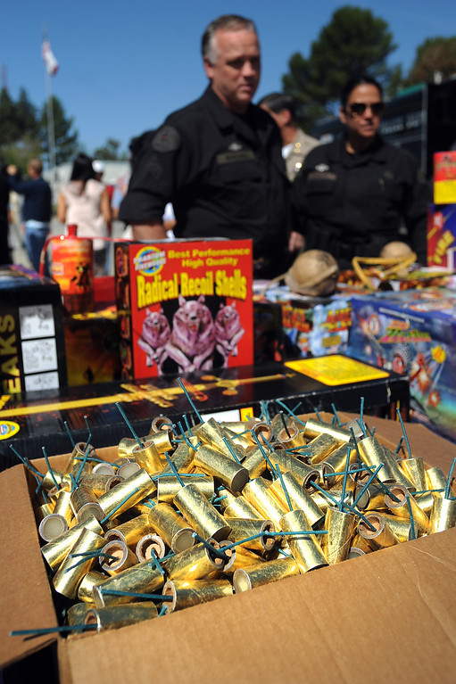 . A box of M-80\'s is displayed during an LAFD news conference regarding the use of fireworks as the 4th of July holiday approaches.  Fire and law enforcement officials are encouraging families to attend a professional fireworks show to reduce fires and injuries.(Andy Holzman/Los Angeles Daily News)