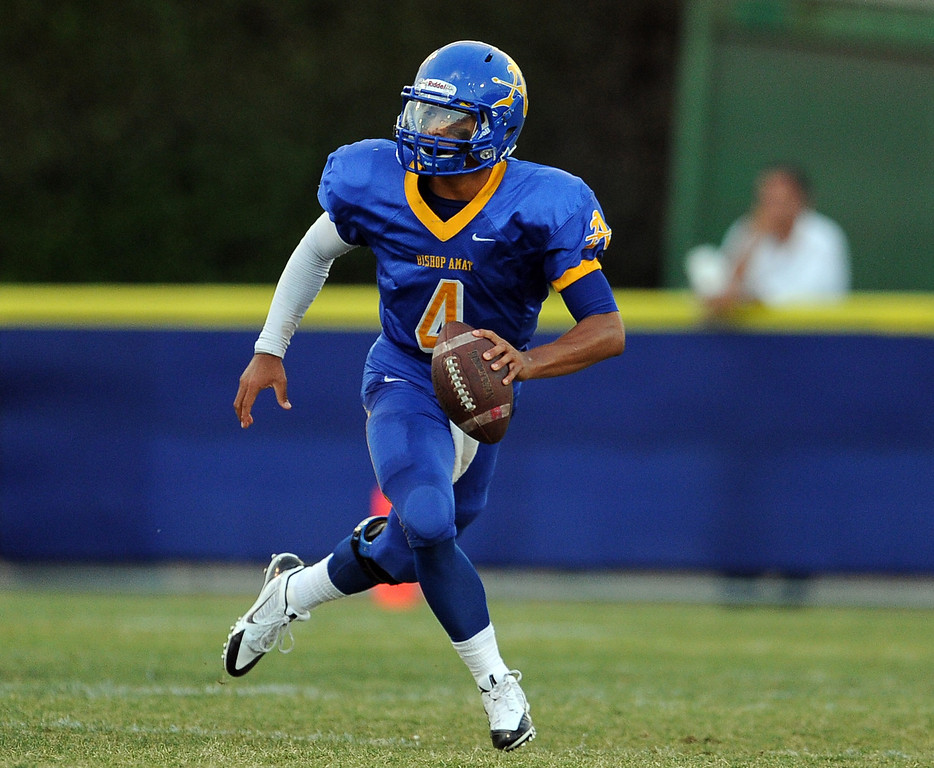 . Bishop Amat quarterback Koa Haynes (C) scrambles against Santa Margarita in the first half of a prep football game at Bishop Amat High School on Friday, Aug. 30, 2013 in La Puente, Calif.   (Keith Birmingham/Pasadena Star-News)