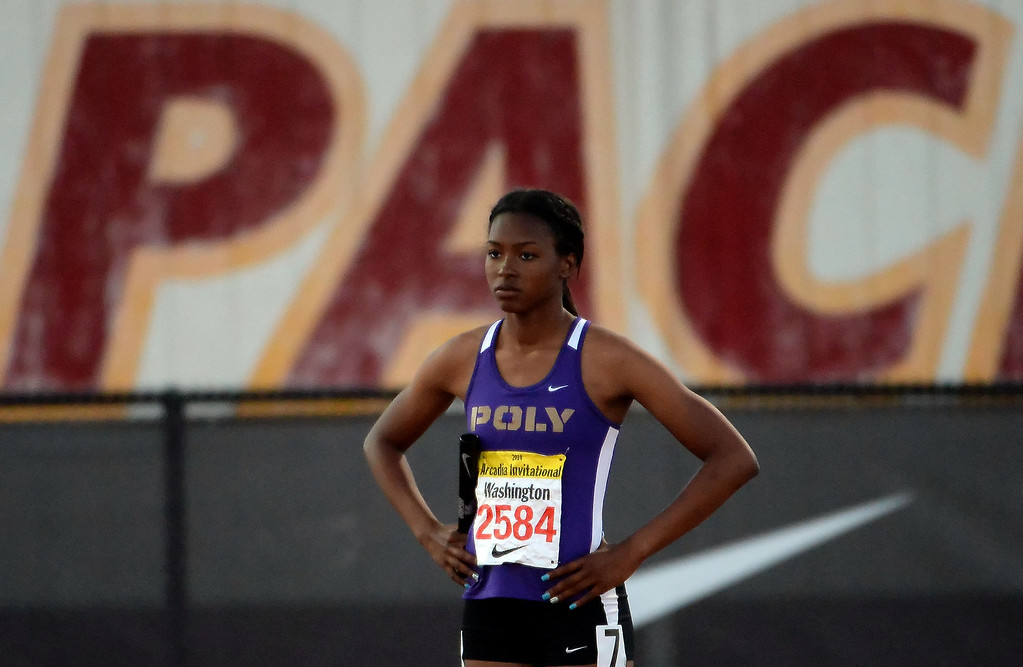 . Long Beach Poly\'s Arianna Washington prior to the 800 Sprint Medley Invitational during the Arcadia Invitational track and field meet at Arcadia High School in Arcadia, Calif., on Friday, April 11, 2014. Long Beach Poly won the race.  (Keith Birmingham Pasadena Star-News)