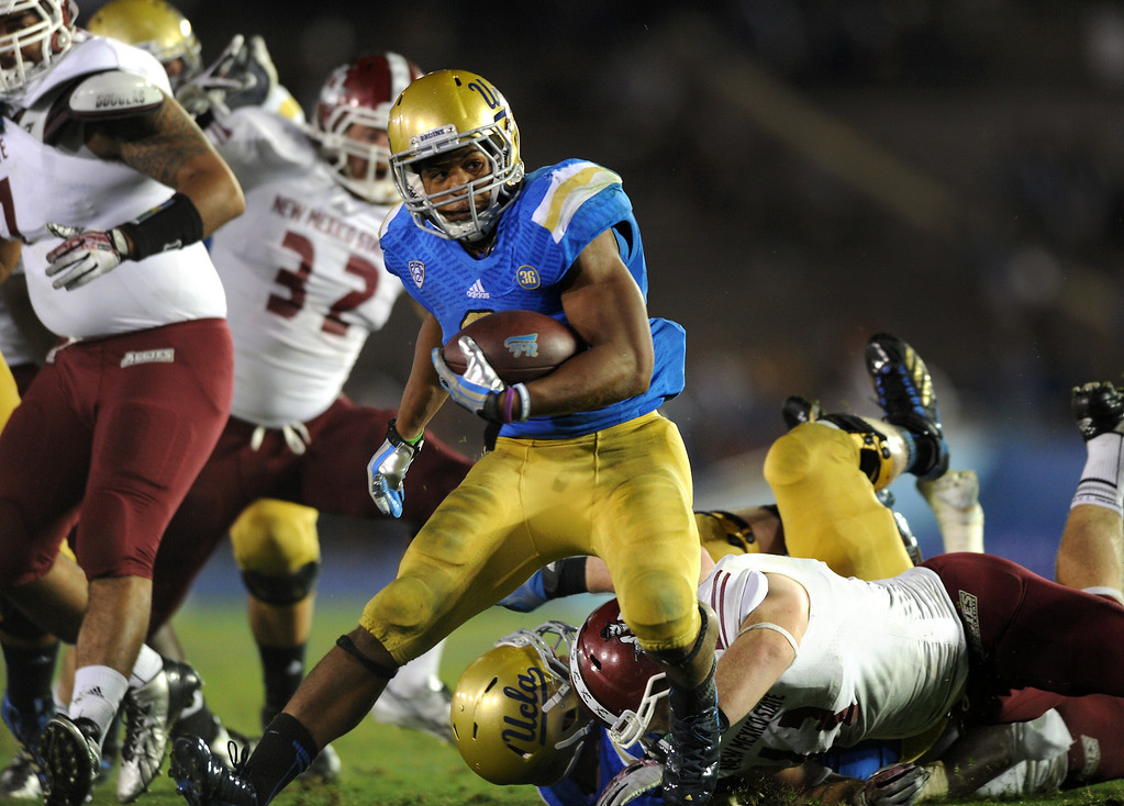. UCLA RB Jordon James cuts back for an 18-yard touchdown run in the third quarter against New Mexico State, Saturday, September 21, 2013, at the Rose Bowl. (Photo by Michael Owen Baker/L.A. Daily News)