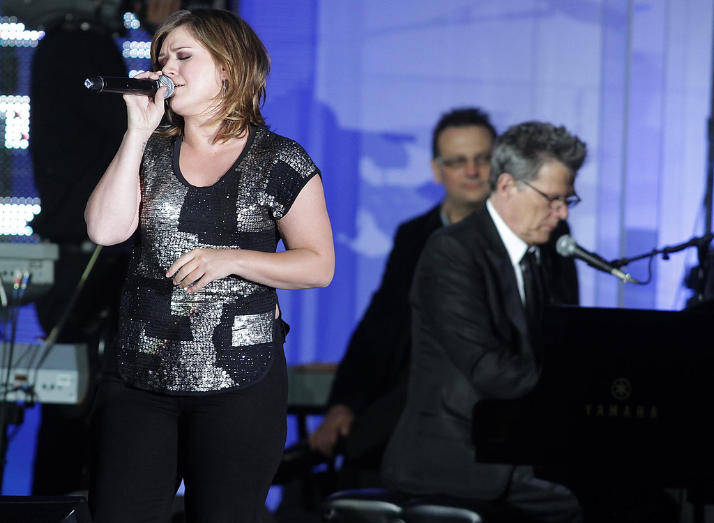 . Kelly Clarkson performs as David Foster plays the piano during Muhammad Ali Celebrity Fight Night XVII on Saturday March. 19, 2011, in Phoenix. (AP Photo/Darryl Webb)
