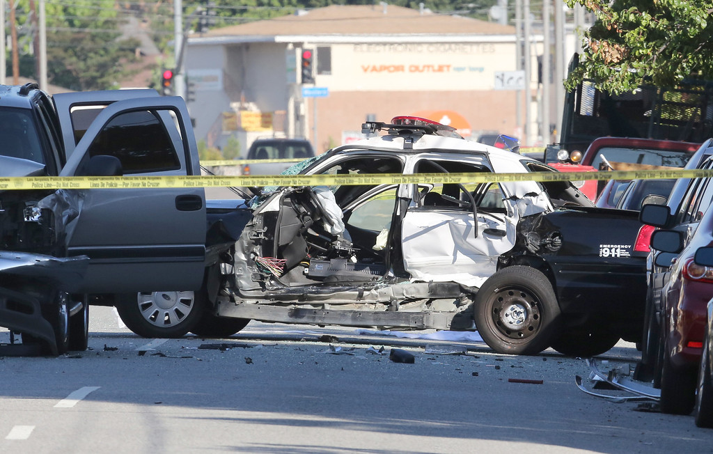 . LAPD officer Roberto Sanchez was killed and another officer was injured when their patrol car was struck Saturday in Harbor City. Chuck Bennett/Staff Photographer